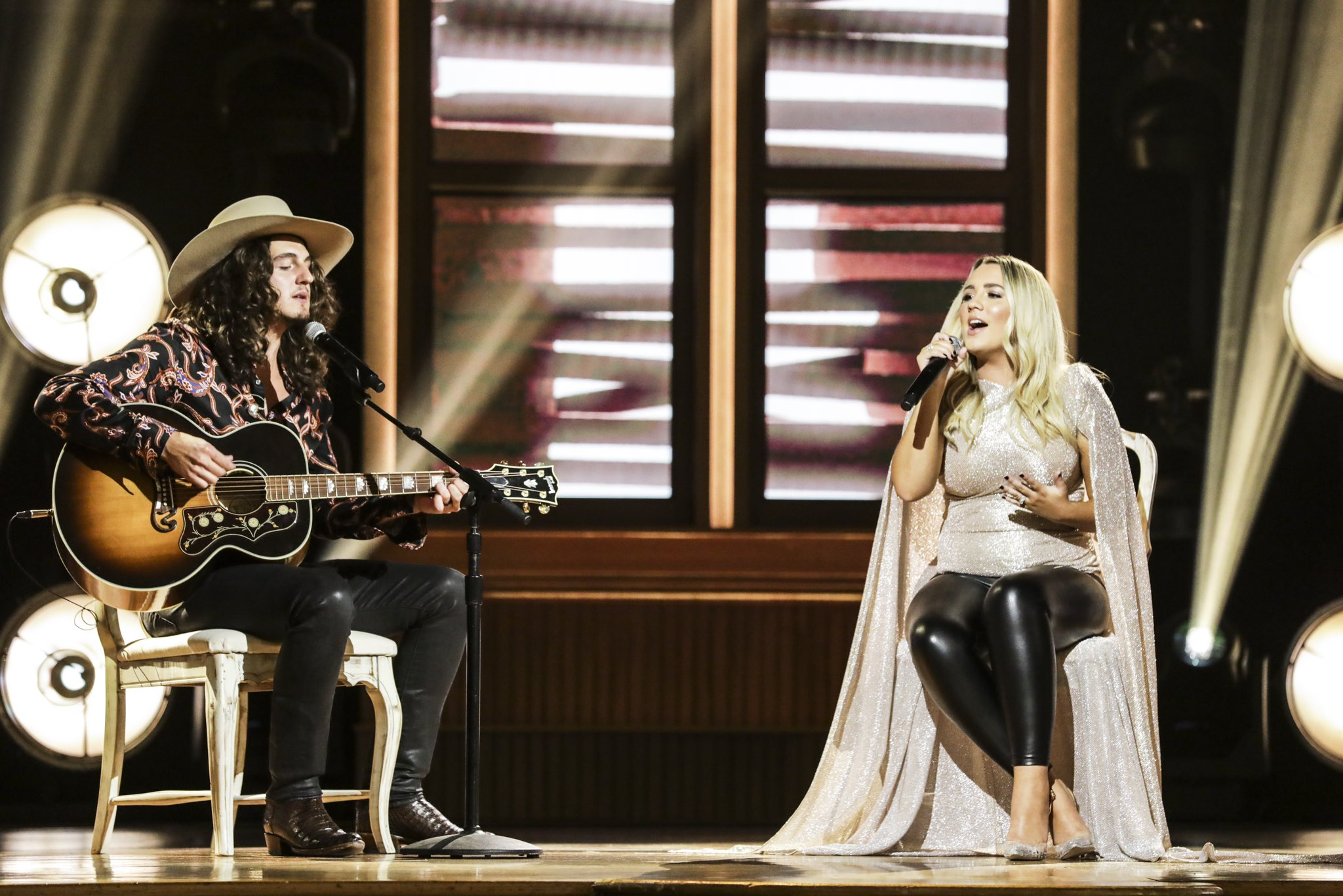 Gabby Barrett performing with Cade Foehner at the Ryman Auditorium in Nashville on the 55th Academy of Country Music Awards
