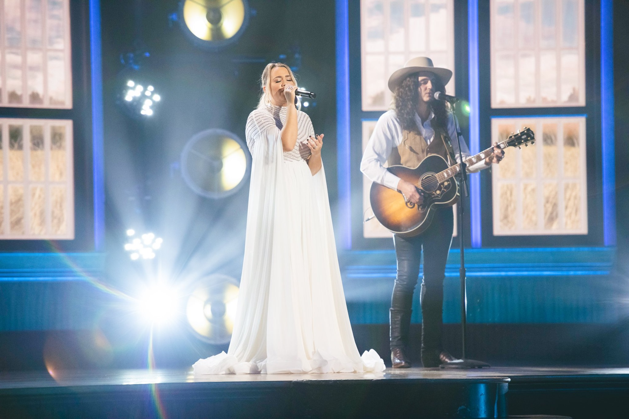 "GABBY BARRETT PERFORMING ""THE GOOD ONES"" WITH CADE FOEHNER AT THE RYMAN AUDITORIUM IN NASHVILLE EXCLUSIVELY FOR XFINITY AHEAD OF THE 55TH ACADEMY OF COUNTRY MUSIC AWARDS. PHOTO CREDIT: ACADEMY OF COUNTRY MUSIC AWARDS"